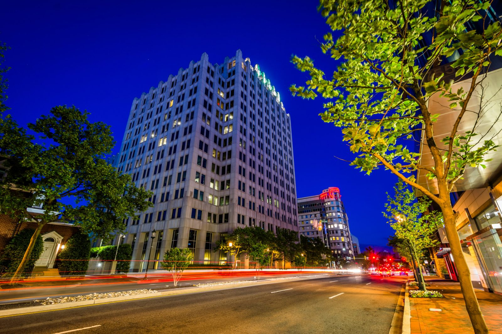 A picture of Bethesda, MD in the evening in an article that helps new residents discover all that Bethesda has to offer.